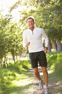 bigstock-Middle-Aged-Man-Jogging-In-Par-13916318